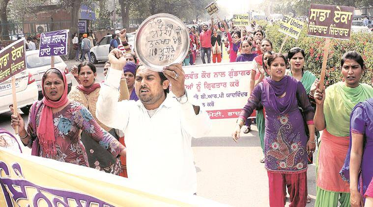 Members of Inclusive volunteer teachers Union protesting for release their eleven month salaries, at sector 61 light point in SAS Nagar on Monday, february 29 2016. Express photo by Jasbir Malhi