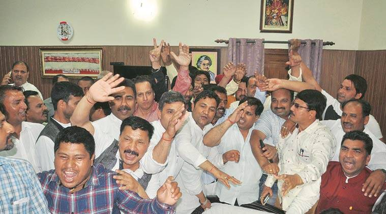 Congress workers cheer after the HC order. Virender Singh Negi
