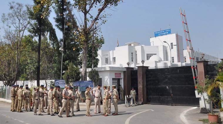 Dehradun: Security person deployed at out side of Uttrakhand Vidhan Sabha in Dehradun on Sunday. PTI Photo (PTI3_27_2016_000164A)