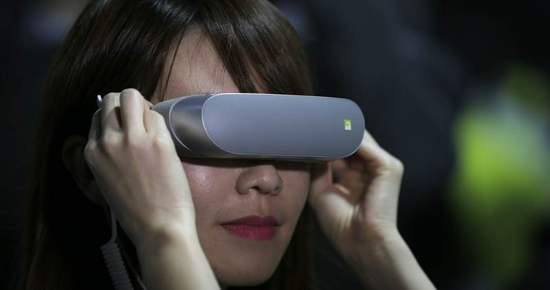 Pricier headsets offer greater comfort, and ones from Oculus, HTC and Sony promise more sophisticated apps (Source: AP)