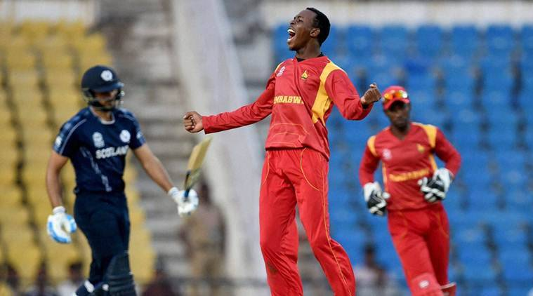 Nagpur: Zimbabwe bowler Wellington Masakadza celebrates the wicket of Scotland's SM Sharif during the ICC T20 World Cup match in Nagpur on Thursday. PTI Photo by Shashank Parade(PTI3_10_2016_000264A)