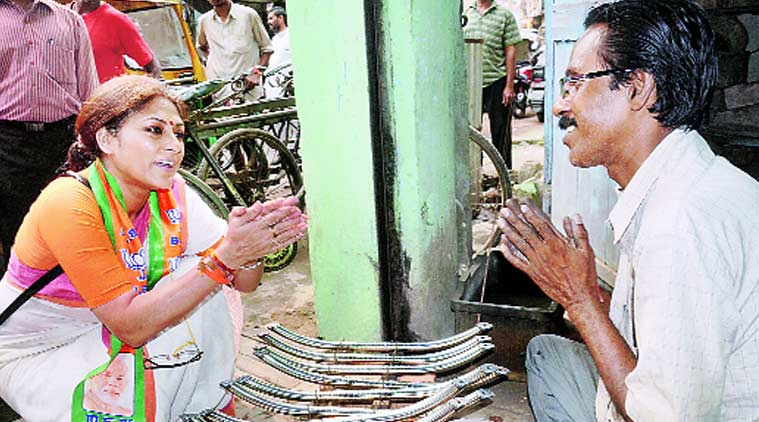 BJP candidate from Howrah North, Rupa Ganguly, campaigns in her constituency on Monday. PTI