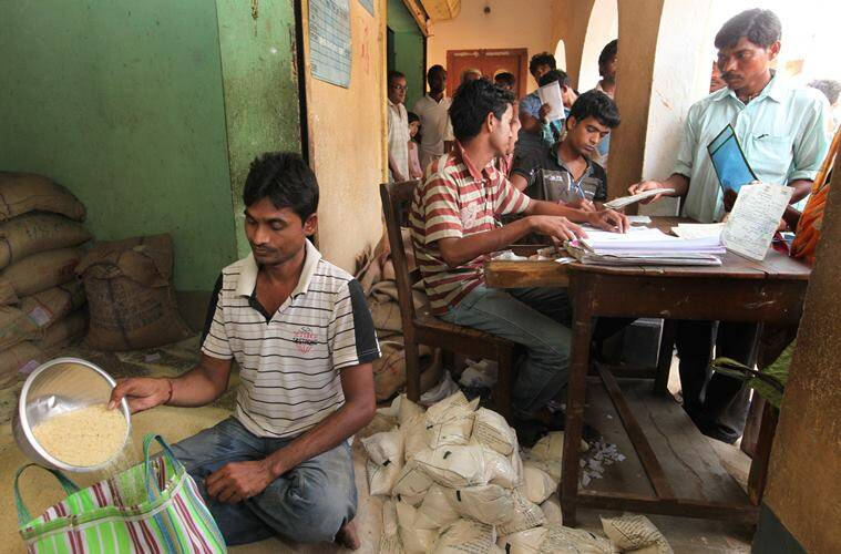 Rice @ Rupees 2 per kg distributed from a ration shop Belatikri under Lalgargh PS on Sunday. Express photo by Partha Paul.Jhargram.27.03.16