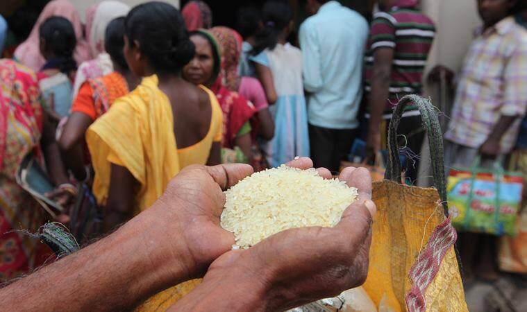 Villagers queue up at a ration shop in Lalgarh for rice at Rs 2 a kg. Partha Paul