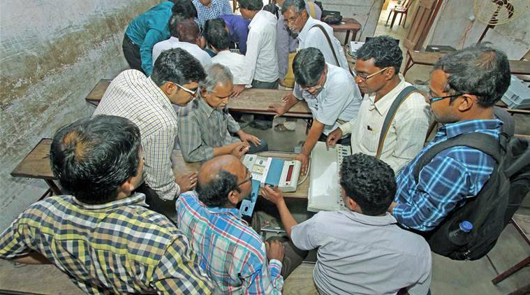 Birbhum: Presiding officers attend an EVM training programme under the direction of Election Commission to know the proper use of EVM to commuters at Bolpur ahead of the state assembly elections in Birbhum district of West Bengal on Sunday. PTI Photo (PTI3_20_2016_000200B)