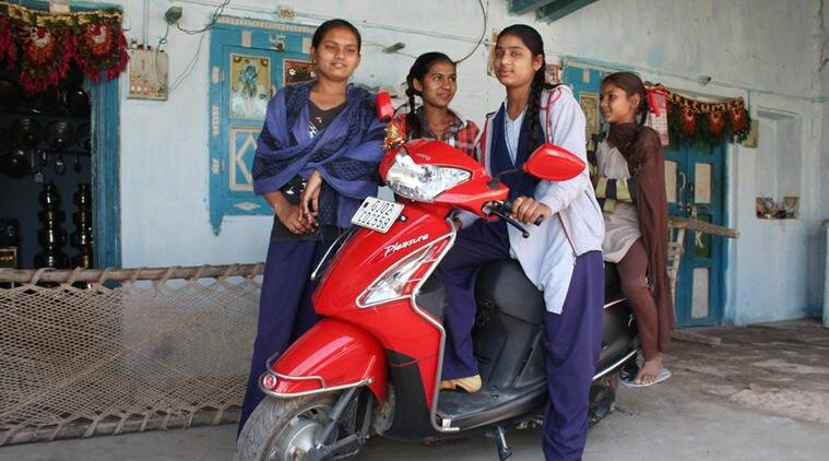Girl power: Laali Thakore (in the driver's seat) with Kiran Vadher and Dharma Thakore at Laali's house in Suraj village. (Express photo by Javed Raja)