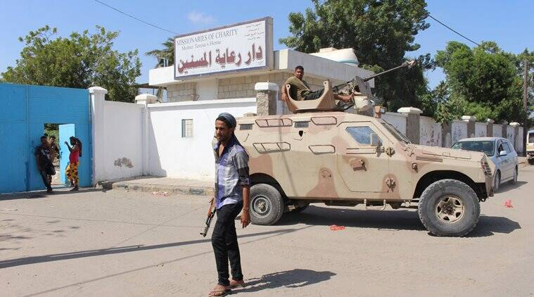 Yemeni security forces gather outside an elderly care home after it was attacked by gunmen in the port city of Aden, Yemen, Friday, March 4, 2016. Unidentified gunmen stormed a retirement home run by Catholic nuns in the southern city of Aden on Friday shooting more than a dozen people to death, including several Indian nuns, Yemeni security officials and witnesses said. (AP Photo/Wael Qubady)
