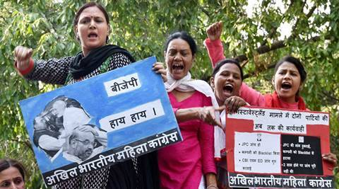 New Delhi: All India Women Congress members staging protest against BJP government over AgustaWestland chopper scam,  at BJP head-office in New Delhi on Friday. PTI Photo(PTI4_29_2016_000225B)