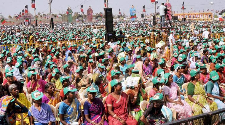 Dharmapuri: AIADMK Supporters at an election campaign meeting of Tamil Nadu Chief Minister and AIADMK Supremo J Jayalalithaa ahead of Tamil Nadu legislative assembly elections 2016, in Dharmapuri on Wednesday. PTI Photo (PTI4_13_2016_000349B)