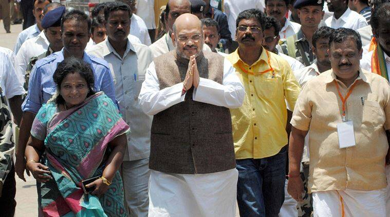 Trichy: BJP President Amit Shah arrives to attend a public meeting ahead of Tamil Nadu legislative assembly elections 2016, in Trichy on Wednesday. PTI Photo  (PTI4_13_2016_000162B)