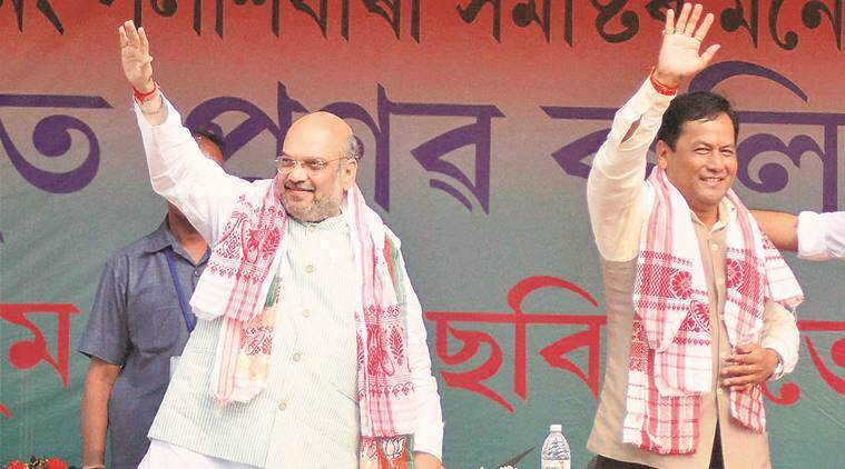 Amit Shah with CM candidate Sarbananda Sonowal at a rally in Palashbari Tuesday. PTI