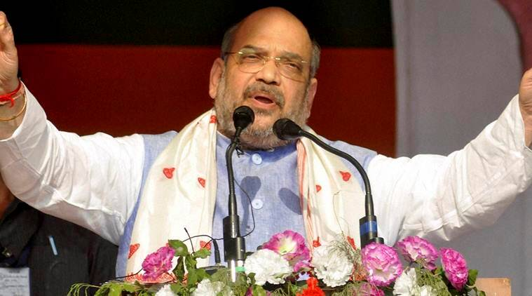 Sualkuchi: BJP president Amit Shah addressing an election rally at Sualkuchi in Kamrup district of Assam on Saturday. PTI Photo(PTI4_9_2016_000115A)