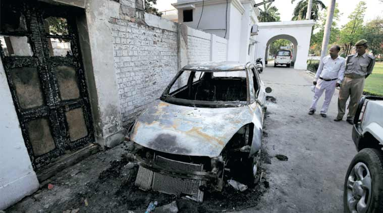 A car burnt during the clash at Aligarh Muslim University. (Express Photo: Ravi Kanojia)