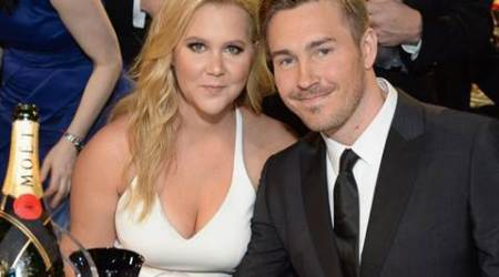 Amy Schumer warned boyfriend Ben Hanisch's mom about media scrutiny