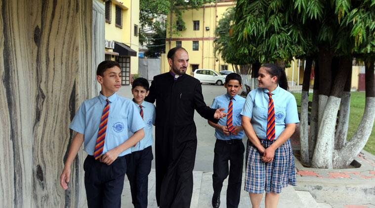 Father Zaven Yazichyan with students of the Armenian College and Philanthropic academy in Kolkata