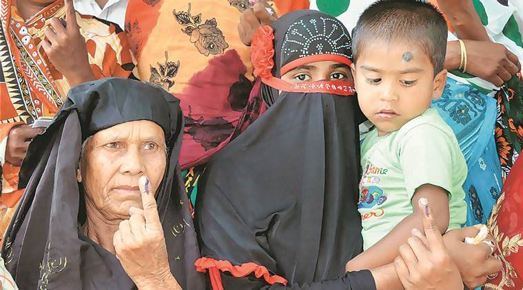 Nagaon: Muslim women showing their ink marked fingers after casting votes during the state assembly elections in Nagaon, Assam on Monday. PTI Photo