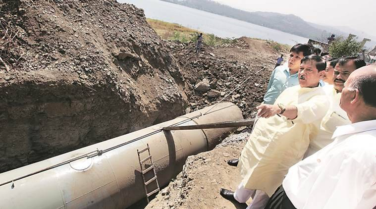 Girish Bapat on Wednesday inspects the Khadakwasla-end of the new closed pipeline, which will carry water from Khadakwasla dam (right) to Parvati. It will be inaugurated Thursday and is set to become operational this month-end.