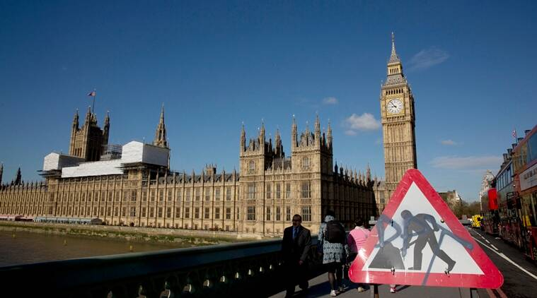 A roadworks sign stands on Westminster Bridge, near the Houses of Parliament and Elizabeth Tower, which houses the Big Ben bell in London, Tuesday, April 26, 2016. Officials say the chimes of Britain's Big Ben bell will fall silent for several months during a three-year restoration of Parliament's crumbling clock tower. (AP Photo/Matt Dunham)