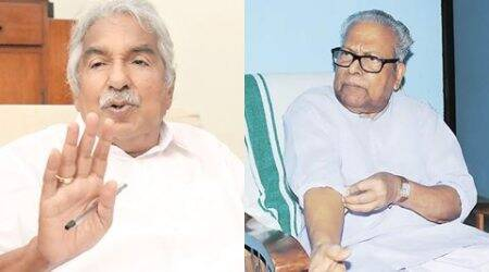 Kerala CM Chandy files defamation suit against V S Achuthanandan, complains to EC