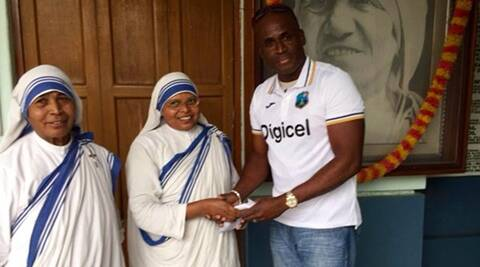 West Indies team manager Rawl Lewis donates to Mother Teresa's charity