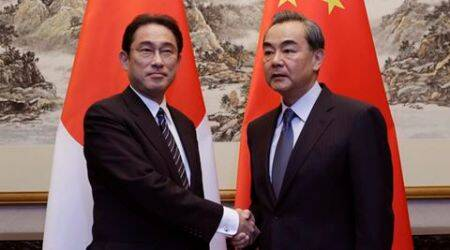 Japanese Foreign Minister Fumio Kishida, left, shakes hands with China's Foreign Minister Wang Yi during a meeting at Diaoyutai State Guesthouse, in Beijing, China, Saturday, April 30, 2016. (Jason Lee/Pool Photo via AP)