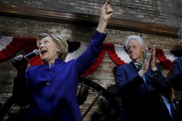 Democratic U.S. presidential candidate Hillary Clinton speaks to a gathering of Irish American supporters as her husband former U.S. president Bill Clinton applauds at a campaign in the Manhattan borough of New York City, April 18, 2016. REUTERS/Mike Segar