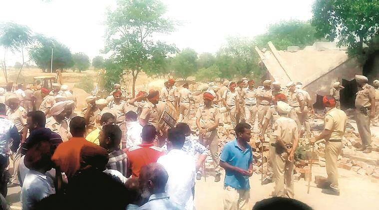 Police force while  skeletons of dead  cows found burried underground being dig out near Dhuri in Sangrur.