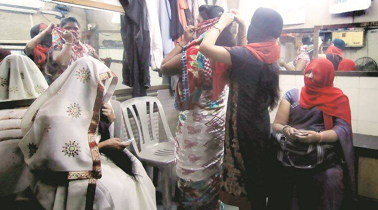 Girls are getting ready in their changing room in Ellora Resturant and Bar in Borivili (E) before meeting the media. The Supreme Court today stayed a state law banning dance bars in Maharashtra. Express Photo by Amit Chakravarty 15-10-15, Mumbai