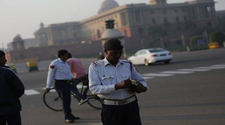 Traffic policemen at the vikay chowk on the second day of the ODDEVEN in New Delhi on saturday. Express Photo by Tashi Tobgyal New Delhi 020116