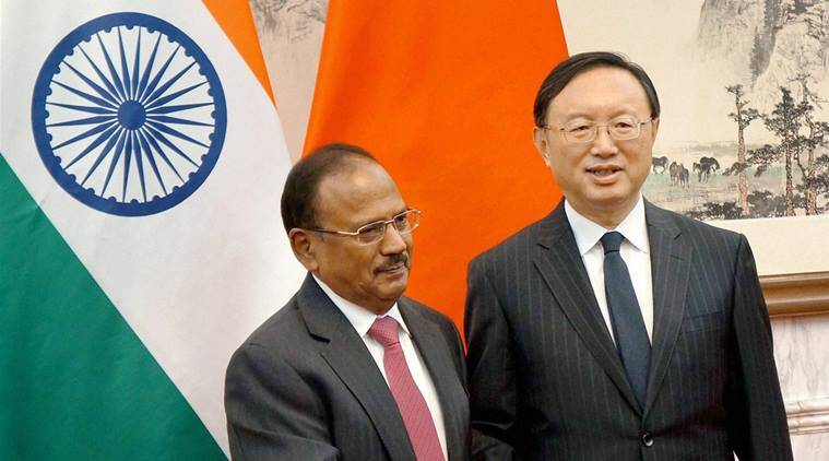 Beijing: National Security Advisor, Ajit Doval being welcomed by China's State Councillor, Yang Jiechi at the 19th India-China Boundary talks in Beijing on Wednesday. PTI Photo  (PTI4_20_2016_000122B)