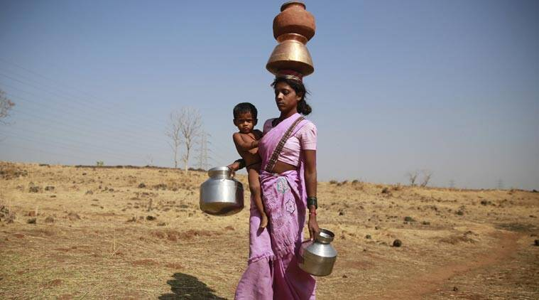 A woman along with her son walks to get water from a communal tube well at Raichi Wadi village, 120 kilometers (75 miles) north-east of Mumbai, India. (Source: AP)