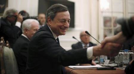 European Central Bank (ECB) President Mario Draghi shakes hands during the president's advisory council of state at Belem Palace in Lisbon, Portugal April 7, 2016.  REUTERS/Rafael Marchante