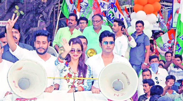 Tollywood actors Ankush (right) and Bonny with filmmaker Raj Chakraborty campaign at Bolpur in Birbhum district on Tuesday. PTI