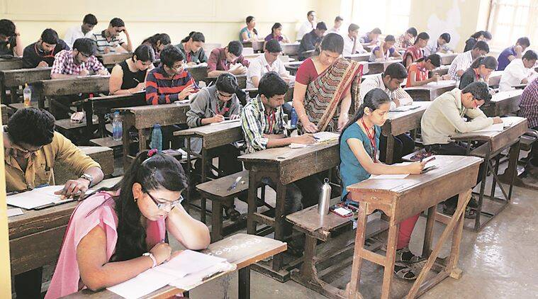 Students writing Higher Secondary Certificate (class 12 board exam) examinations which started on Saturday and will continue till March 29. Students reported 30 minutes before the official time as they were given 20 minutes to fill in their personal information in the answer sheets and another 10 minutes to read the question paper.Express Photo By Sandeep Daundkar, Pune, 21.02.2015