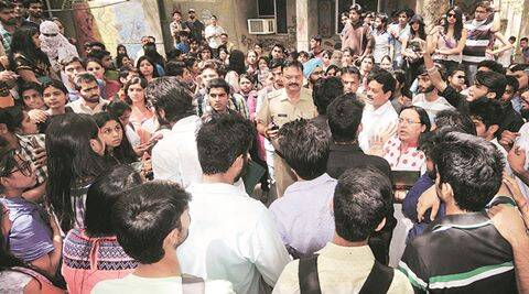 Students protest turns violent in FDDI Noida  over giving fake digree, they broke severel vehicles and FDDI's building -Express Photo by Gajendra Yadav,21/04/2016