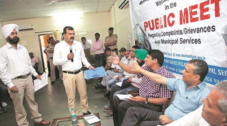 Residents of Manimjara and MC officers during public grievances meeting at community centre at Modren housing complex, Manimajra in Chandigarh on Monday, April 18 2016. Express photo by Jaipal Singh