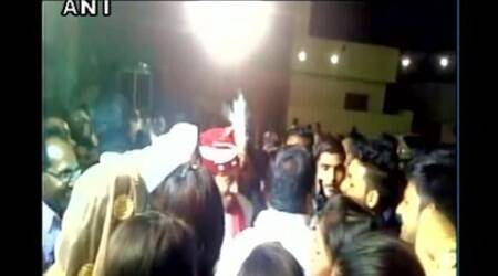 Watch: Celebratory firing injures groom during a weddingceremony