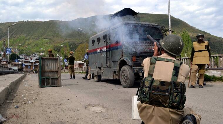 Police use tear gas shell during clashes in Baramulla over attacks on students in Kupwara district. (Source: Express photo by Shuaib Masoodi)