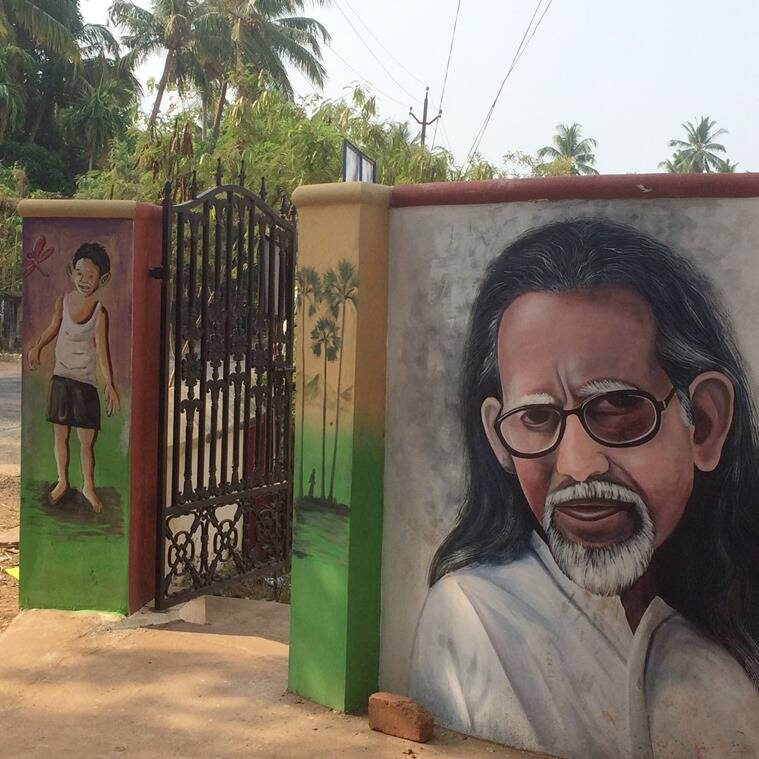 Murals at the entrance of the school ground where the play was staged.