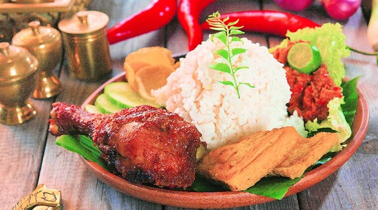 A plate of ayam and rice.