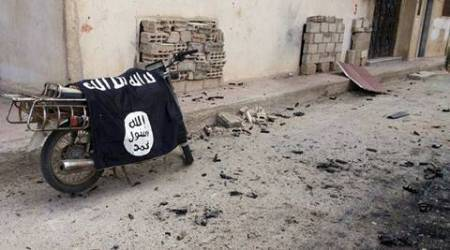 A flag belonging to the Islamic State fighters is seen on a motorbike after forces loyal to Syria's President Bashar al-Assad  recaptured the historic city of Palmyra, in Homs Governorate in this handout picture provided by SANA on March 27, 2016. REUTERS/SANA/Handout via Reuters ATTENTION EDITORS - THIS PICTURE WAS PROVIDED BY A THIRD PARTY. REUTERS IS UNABLE TO INDEPENDENTLY VERIFY THE AUTHENTICITY, CONTENT, LOCATION OR DATE OF THIS IMAGE. EDITORIAL USE ONLY. NOT FOR SALE FOR MARKETING OR ADVERTISING CAMPAIGNS. THIS PICTURE IS DISTRIBUTED EXACTLY AS RECEIVED BY REUTERS, AS A SERVICE TO CLIENTS.