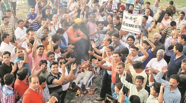 Members of Chandigarh Jewelers Association burn the effigy of Arun Jatiley Union Minister of Finance and Corporate Affairs in India during the  protest at sector45 in Chandigarh on Wednesday, April 06 2016. Express photo