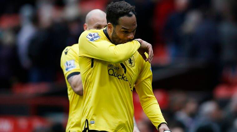 Joleon Lescott dejected at the end of the match after being relegated from the Premier League. (Source: Reuters)