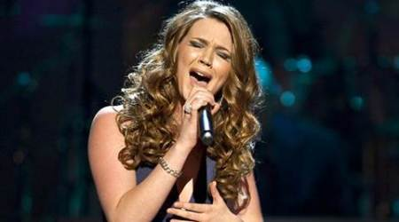 Joss Stone cancels gigs to care for sickdog