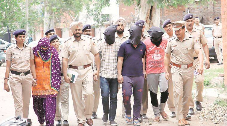 The accused in police custody on Friday. Express photo by Jaipal Singh