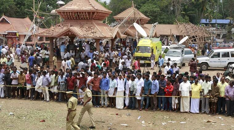 Policemen cordon off the area after a fire broke out at a temple in Kollam in the southern state of Kerala, India, April 10, 2016. A huge fire swept through a temple in India's southern Kerala state early on Sunday (April 10), killing nearly 80 people and injuring over 200 gathered for a fireworks display to mark the start of the local Hindu new year. REUTERS/Sivaram V