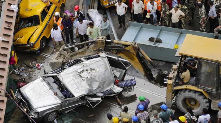 A long section of a road overpass under construction collapsed Wednesday in a crowded Kolkata neighborhood, with tons of concrete and steel slamming into midday traffic, killing over 20 and injuring many. (Source:AP)