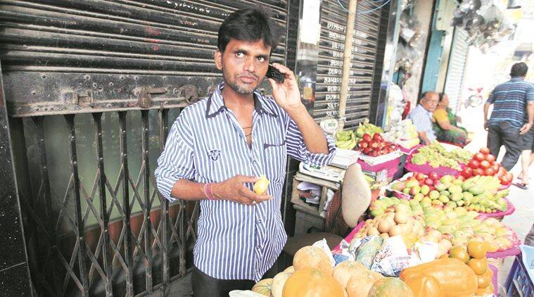 A day in the lifeof Vinod Sonkar , 37, fruit vendor selling fruits just in front of collapsed flyover in Kolkata. Express photo by Partha Paul