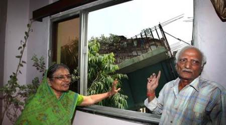 Gayatri devi Nagnolia (66) and Shiv Kumar Nagnolia (72) check out the crash site from their window . Express photo by Partha Paul. Kolkata.06.04.16