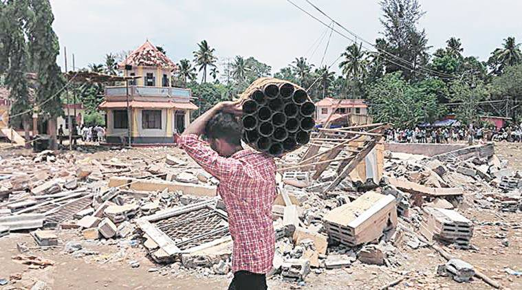 kerala temple tragedy, puttingal devi temple fire, rules violated at kerala temple, reason for fire at kerala temple, culprits of puttingal temple fire, temple fire reason